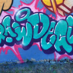 Raw Deal text on a wall