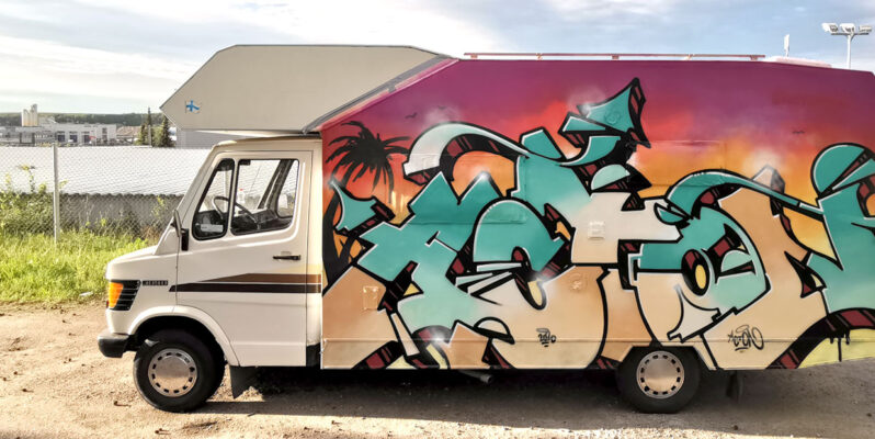 camper van with graffiti painting