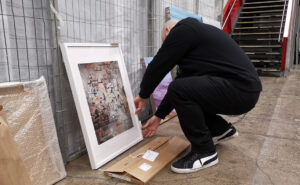 Artist unpacking canvases